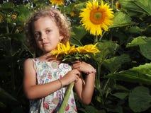Menina com girassol Fotos de Stock Royalty Free
