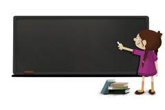 Menina com giz à disposição que escreve em um quadro-negro Fotografia de Stock Royalty Free