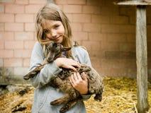 Menina com goatling Fotografia de Stock