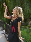 Menina com grânulos Fotos de Stock Royalty Free