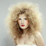Menina com hair-do de choque Imagem de Stock Royalty Free