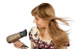 Menina com hairdryer Fotografia de Stock