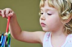Menina com lápis Fotos de Stock