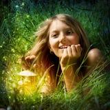 Menina com lâmpada Imagem de Stock Royalty Free