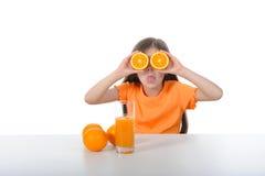 Menina com laranja Fotos de Stock