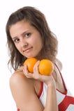 A menina com laranjas Fotos de Stock Royalty Free