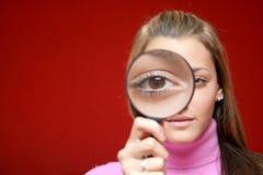 Menina com lente Fotografia de Stock