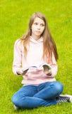 Menina com livro Imagens de Stock