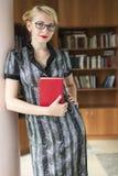 Menina com livro Imagem de Stock