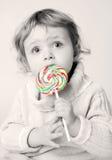 Menina com lollipop imagem de stock