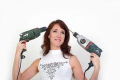 Menina com máquina de perfuração Foto de Stock