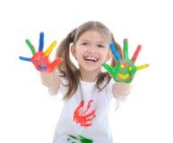 Menina com mãos em uma pintura Imagem de Stock Royalty Free