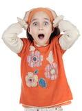 Menina com mãos na cabeça Imagens de Stock