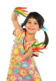 Menina com mãos pintadas fotografia de stock royalty free