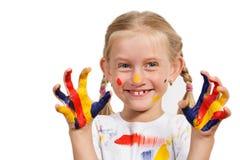 Menina com mãos pintadas Imagem de Stock