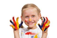 Menina com mãos pintadas Fotos de Stock Royalty Free