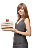 Menina com a maçã e uma pilha de livros Fotos de Stock Royalty Free