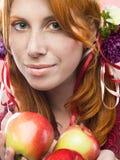 Menina com maçãs Fotografia de Stock