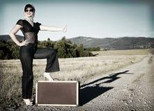 Menina com mala de viagem Fotografia de Stock Royalty Free