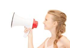 Menina com megafone Fotografia de Stock