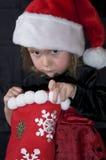 Menina com meia do Natal Fotografia de Stock Royalty Free