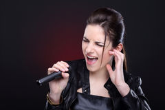 Menina com microfone Fotografia de Stock
