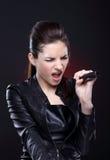 Menina com microfone Fotos de Stock Royalty Free