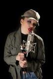 Menina com microfone que faz caretas Imagem de Stock Royalty Free