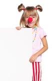 Menina com nariz e placa do palhaço Imagens de Stock