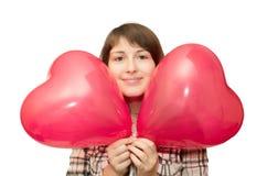 Menina com o balão sob a forma do coração Imagens de Stock Royalty Free
