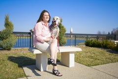 Menina com o cão Fotos de Stock
