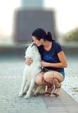 Menina com o cão para uma caminhada Foto de Stock Royalty Free