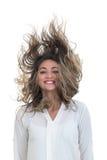 A menina com o cabelo tornando-se em um fundo branco Imagens de Stock Royalty Free