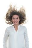 A menina com o cabelo tornando-se em um fundo branco Fotos de Stock
