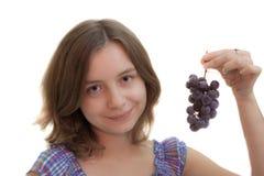 Menina com o conjunto de uvas Fotografia de Stock