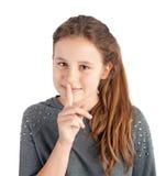 Menina com o dedo em seus bordos Imagens de Stock Royalty Free