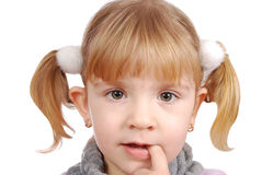 Menina com o dedo na boca Fotografia de Stock Royalty Free