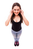 Menina com o dedo na cabeça da dor de cima de Fotografia de Stock Royalty Free