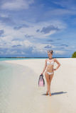 A menina com o equipamento para o mergulho autônomo Foto de Stock Royalty Free