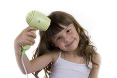 A menina com o hairdryer fotos de stock royalty free