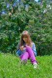 Menina com o jogador Fotos de Stock