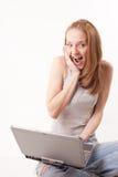 Menina com o portátil no branco Fotografia de Stock