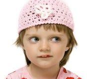 Menina com o tampão cor-de-rosa - isolado no branco Foto de Stock Royalty Free