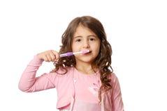 Menina com o tooth-brush sobre o branco imagens de stock royalty free