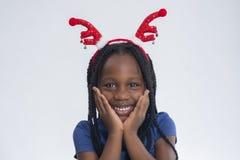 Menina com orelha da rena fotografia de stock