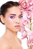 Menina com orquídea imagem de stock royalty free