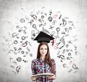 Menina com os ícones abertos do livro e da educação, concretos Imagens de Stock