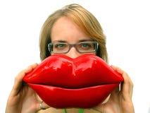 Menina com os bordos vermelhos grandes foto de stock royalty free