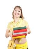 Menina com os livros sobre o branco Fotografia de Stock Royalty Free