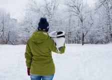 Menina com os patins de gelo brancos imagens de stock royalty free